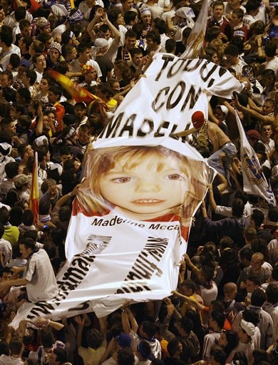 """Real Madrid supporters display a banner reading """"all with Madeline,"""" a British girl who disappeared on May 3 in Portugal as they celebrate at Cibeles square that Real Madrid soccer team won the Spanish league title in Madrid."""