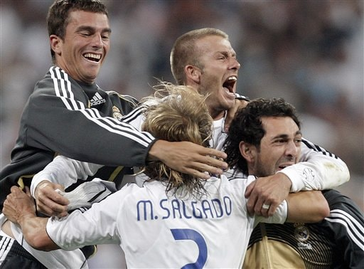 Real Madrid player David Beckham, center, celebrates after a teammate scored during the Spanish League soccer match against Mallorca in Madrid.