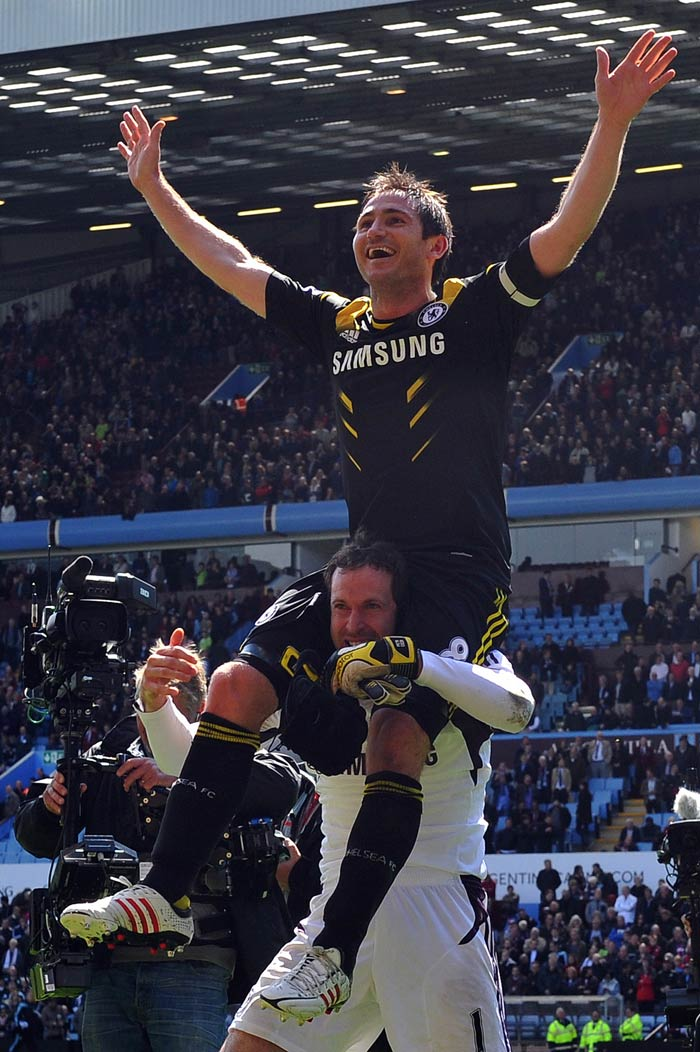 Lampard did not seem to mind anything on the day as he is seen here responding to the applause while getting a fantastic view of it all from Petr Cech's shoulders.