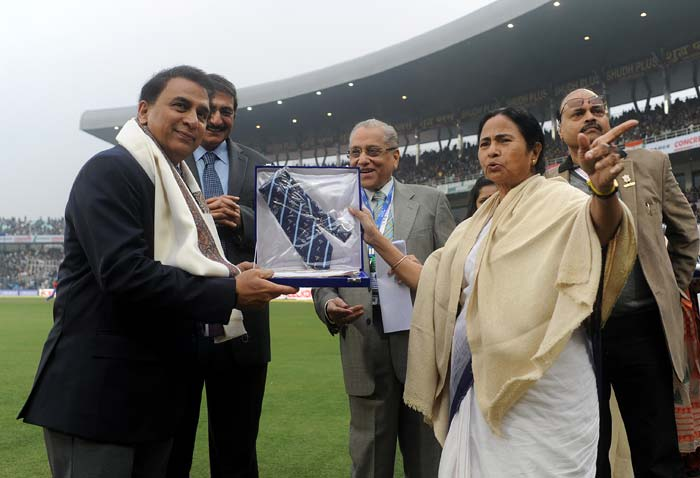 Sunil Gavaskar is seen here with the commemorative tie presented to him. (Image courtesy: BCCI)