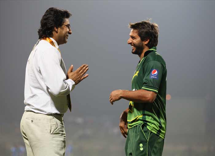 And after all the fun and frolic, sometimes its just best to listen to your seniors and get those valuable tips. Pakistan skipper Shahid Afridi and former pacer Wasim Akram share a light moment on the sidelines of a match. (Getty Images)