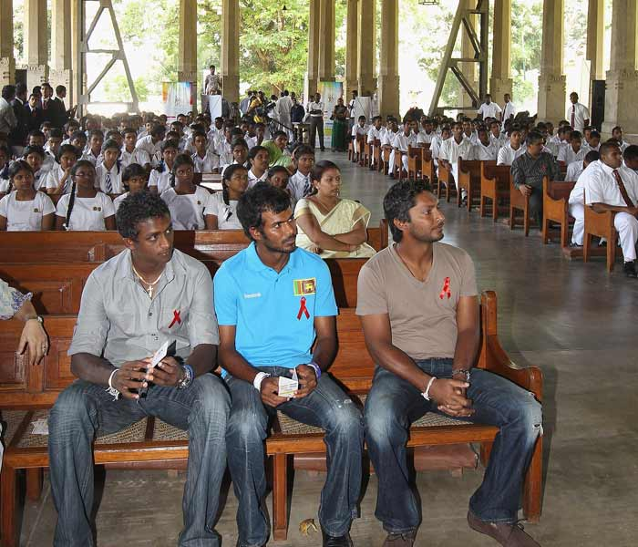 Social responsibility is high priority with others as well. Sri Lankan skipper Kumar Sangakkara is seen here with fellow cricketers at his former college to raise awareness on AIDS. (Getty Images)