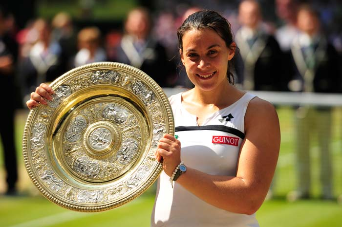 28-year-old Bartoli poses with her maiden Grand Slam title. She now has 8 WTA titles to her name.