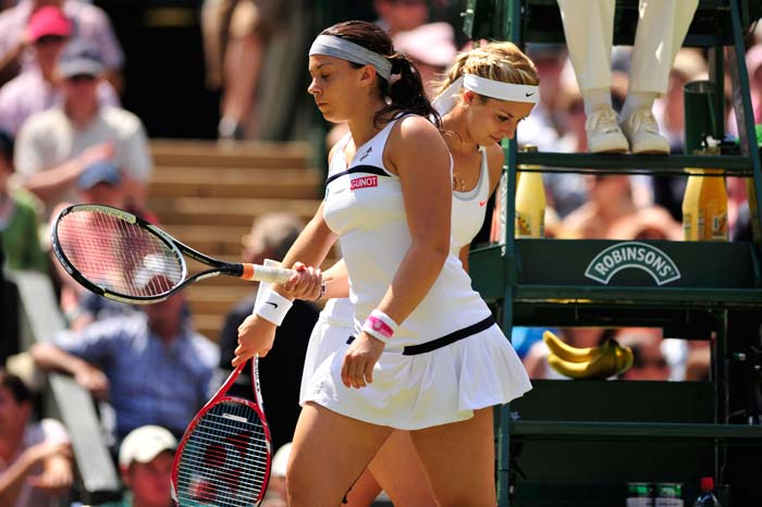 The 2013 Wimbledon women's singles final was between two unfancied WTA professionals. One a 28-year-old experienced Marion Bartoli of France, and 23-year-old glittering German Sabine Lisicki. (All AFP and AP images)
