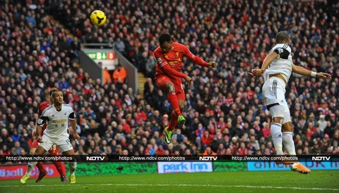 Sturridge is seen here, taking the aerial route, just before one of his two goals.