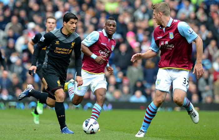 Liverpool came from behind to win 2-1 at Aston Villa on Sunday in an entertaining game that kept Paul Lambert's side entrenched in the Premier League relegation zone.