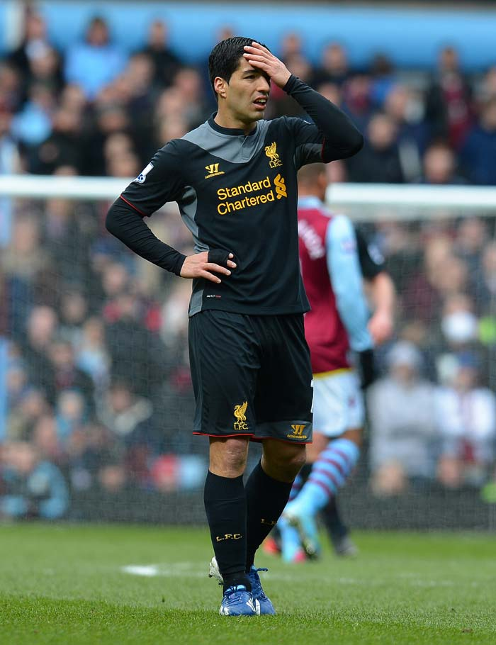 Uruguayan striker Luis Suarez reacts during the clash.<br><br>His two attempts on goal were blocked by Villa goalkeeper Brad Guzan.