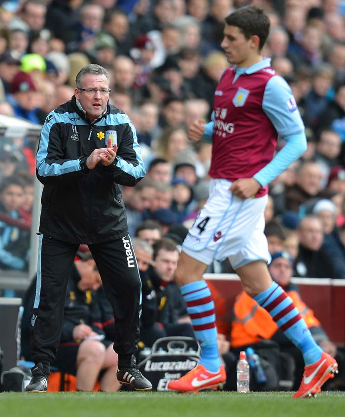 Villa's Scottish manager Paul Lambert (L) reacts during the match.