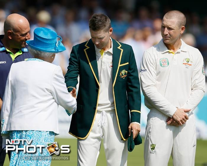 The head of state -- wearing a blue hat, blue dress and white jacket with blue trim -- was first introduced to the Australia team as captain Michael Clarke led her down the line of players. (All AP and AFP images)