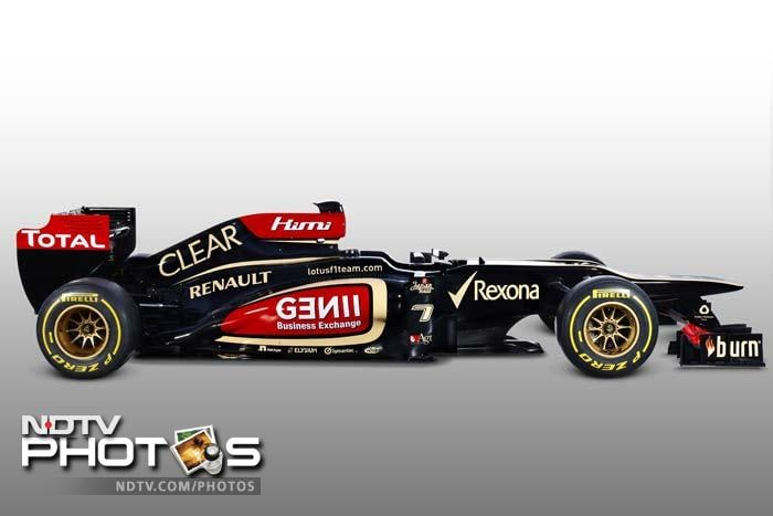 Decked in black, red and gold the new Lotus E21 is unabashedly flashy. <br><br> Yet the team that finished fourth in the 2012 constructors standings will hope the on-track performances match up to the cosmetic enhancements. (Photo credit: AFP PHOTO/LOTUS FORMULA ONE TEAM)