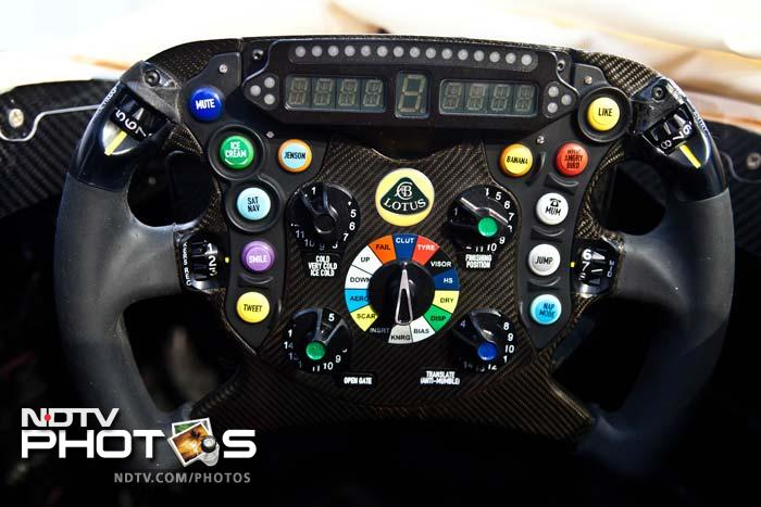 The ingenious steering wheel is specifically designed for maverick Kimi Raikkonen. With buttons like 'ice cream', 'angry birds', 'banana' and 'tweet' the steering is quirky yet cool. (Photo credit: AFP PHOTO/LOTUS FORMULA ONE TEAM)