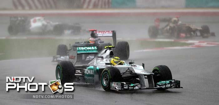 Mercedes driver Nico Rosberg of Germany powers his car during Formula One's Malaysian Grand Prix at the Sepang International Circuit.