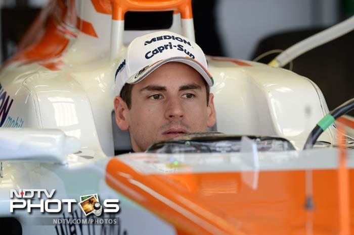 Force India driver Adrian Sutil of Germany sits inside his race car during the first practice session at the Malaysian Grand Prix.