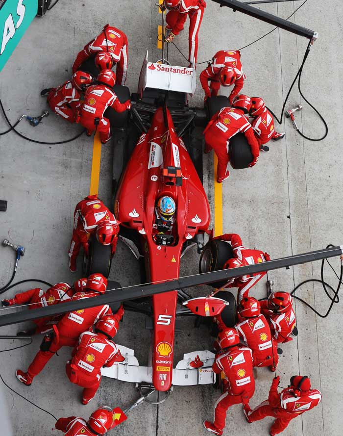 Fernando Alonso of Spain and Ferrari drives in for a pit-stop during the Malaysian Formula One Grand Prix at the Sepang Circuit. (Getty Images)