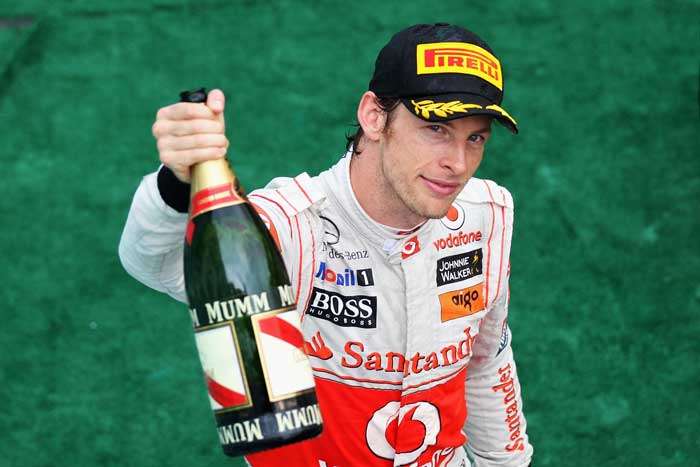 Second placed Jenson Button of Great Britain and McLaren celebrates on the podium after the Malaysian Grand Prix at the Sepang Circuit. (Getty Images)