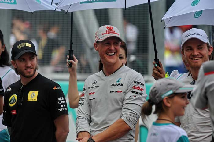 Mercedes driver Michael Schumacher (C) , Lotus-Renault driver Nick Heidfeld(L) and Mercedes driver Nico Rosberg share a lighter moment during the parade ceremony of Formula One's Malaysian Grand Prix at Sepang. (AFP Photo)