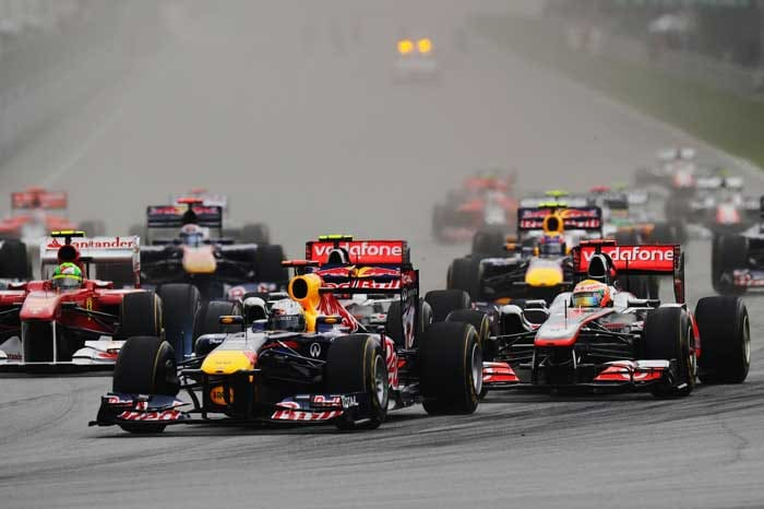 Sebastian Vettel of Germany and Red Bull Racing leads from Lewis Hamilton of Great Britain and McLaren at the start of the Malaysian Formula One Grand Prix at the Sepang Circuit. (Getty Images)