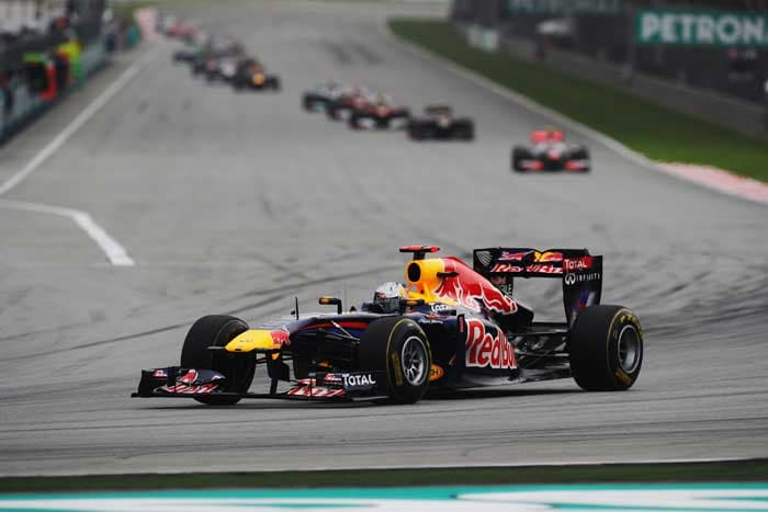 Sebastian Vettel of Germany and Red Bull Racing takes a big early lead at the start of the Malaysian Grand Prix at the Sepang Circuit. (Getty Images)