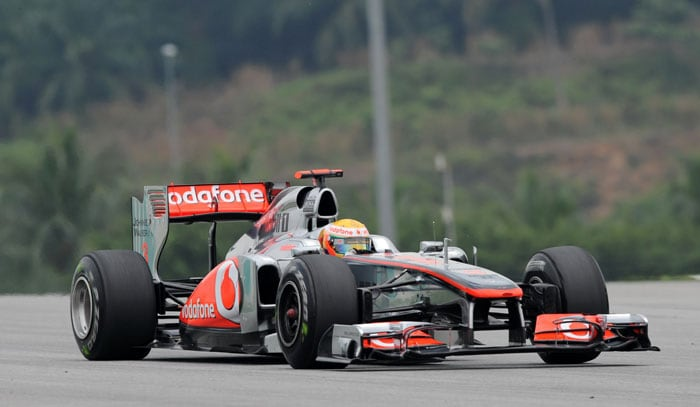 McLaren-Mercedes driver Lewis Hamilton of Britain drives during the first practice session of Malaysian Grand Prix at Sepang. (AFP Photo)