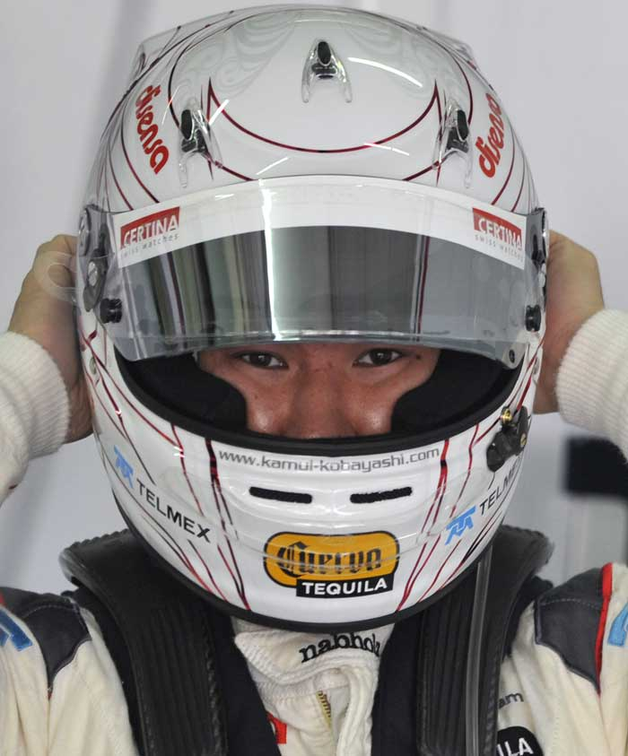 Sauber-Ferrari driver Kamui Kobayashi of Japan adjusts his helmet before the first practice session of Malaysian Grand Prix at Sepang. (AFP Photo)