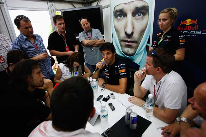 Mark Webber of Red Bull Racing is interviewed by the media during previews to the Malaysian Formula One Grand Prix at the Sepang Circuit. (Getty Images)