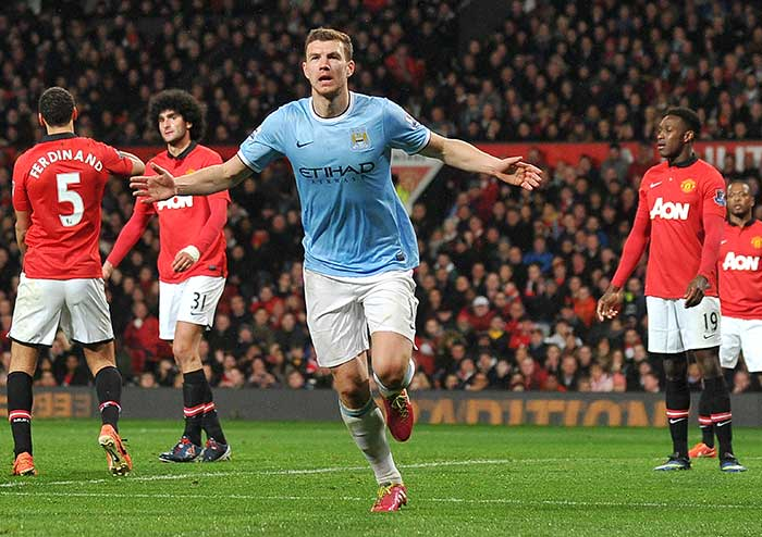 Edin Dzeko scored twice as Manchester City heaped more misery on Manchester United F.C. with a 3-0 victory on Tuesday to move to within three points of Premier League leaders Chelsea with two games in hand. (All images from AFP)