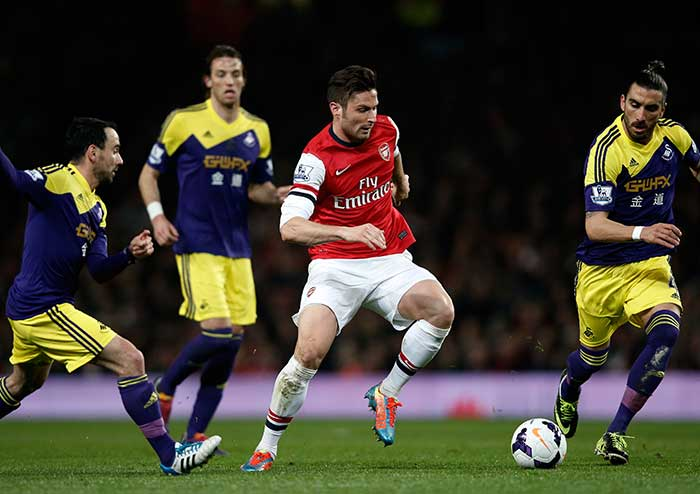 Arsene Wenger's side looked set to bounce back from Saturday's humiliating 6-0 defeat at Chelsea after two goals in the space of 60 seconds midway through the second half from Lukas Podolski and then Olivier Giroud (centre) erased Wilfried Bony's early opener at the Emirates Stadium.