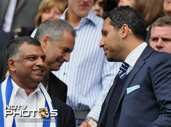 At the end of the match both parties - Manchester City's chairman Khaldoon Al Mubarak (R) and QPR chairman Tony Fernandes (L) - had reasons to be pleased as one team won the title while the other survived the drop.