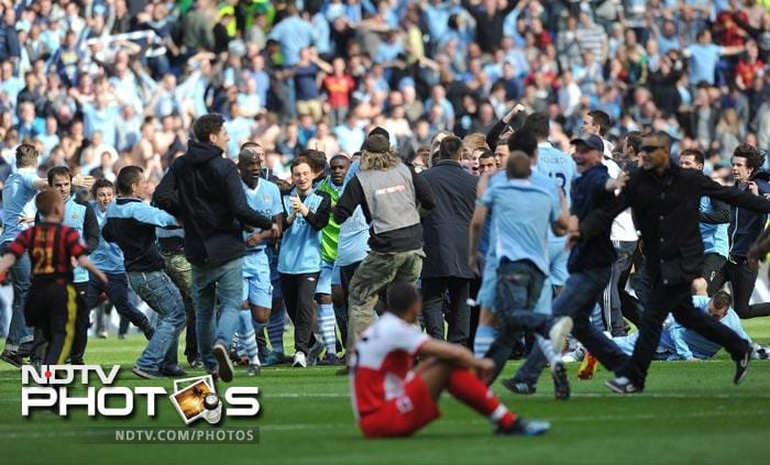 <b>Just champion as City late show seals title<br><br> May 13: Manchester City 3 QPR 2:</b><br><br> Down 1-2 going into stoppage time City looked headed for a heartbreaking loss but goals from Edin Dzeko and Sergio Aguero sealed the title for City. The celebrations that followed were of joy and disbelief.