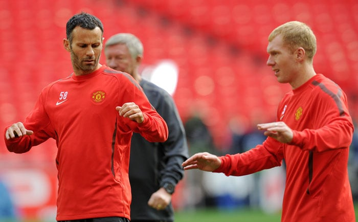 Manchester United will rely on the experience of Ryan Giggs and Paul Scholes to guide the team. The two have been associated with the team for two decades now. (AFP Photo)
