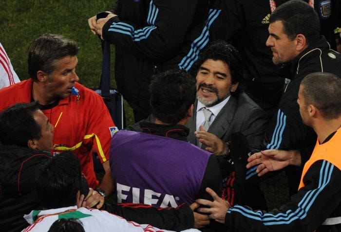 Known for his volatile temperament, Maradona was in the thick of things after a clash between the Argentine and Mexican players during the second round encounter.<br><br> Maradona stood by his players and jumped into the melee only to be rescued later by FIFA officials and his bodyguards.