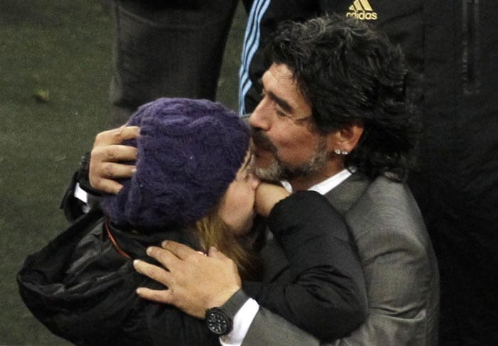 Maradona tried his best to put up a brave front and exited the stadium with his daughter by his side.<br><br> The Argentine great is seen here kissing his daughter Giannina as she too broke down after Argentina's 4-0 loss to Germany.