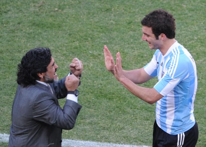 Although criticised for his over dependence on a three man strike force, Maradona's beliefs were vindicated in the match against South Korea which Argentina won 4-2.<br><br> He is seen here celebrating a goal with striker Gonzalo Higuain who netted the first hat-trick of the tournament.<br><br> Every goal scored by his team was cheered with great passion by the coach.