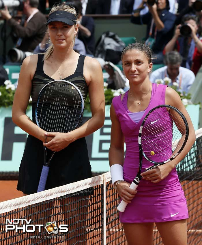 It was the first meeting between the two and the contrasts were stark - notably in height with the 1.88m tall Sharapova towering 24cm above the little Italian.