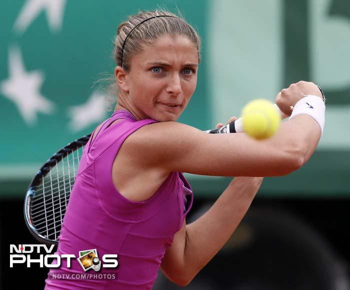 Errani saved two set points at 2-5 and 15-40 down on serve in the eighth game as she started to pull Sharapova from side to side, but the Russian, despite another double fault, served out for the set.