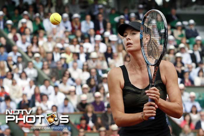 Sharapova broke again to open the second set and moved 2-0 up as the Roland Garros centre court faithful tried to lift the morale of the outgunned Italian.