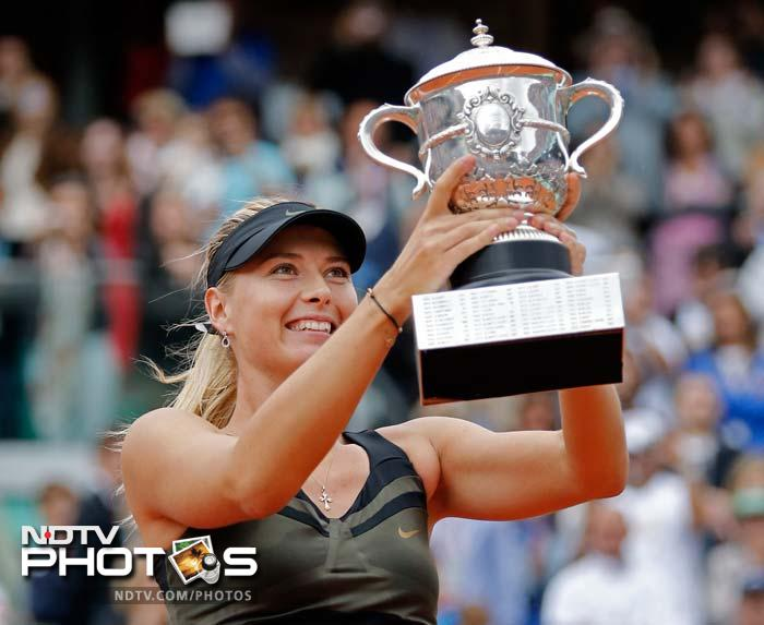 Maria Sharapova became the 10th woman in tennis history to win all four Grand Slam titles when she defeated Sara Errani 6-3, 6-2 in the French Open final. (All AFP and AP Images)