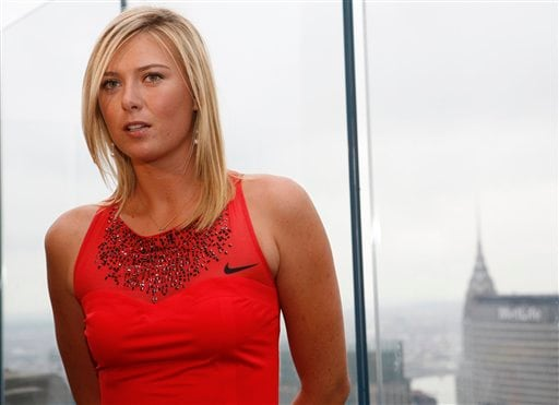 Tennis star Maria Sharapova, of Russia, poses Wednesday, August 22, 2007, in New York, in the Nike tennis dress that she will be wearing for her first round evening match as she defends her title at the 2007 US Open. The crystal encrusted dress is inspired by the New York City skyline.