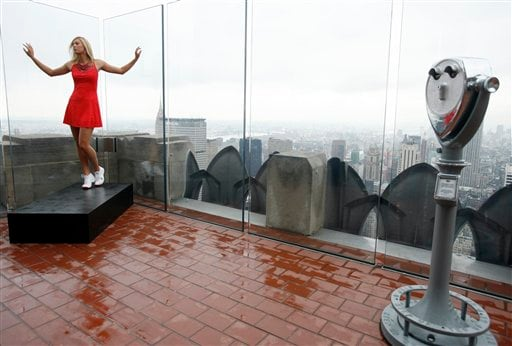 Tennis star Maria Sharapova poses in the Nike tennis dress, Wednesday, August 22, 2007, in New York, that she will be wearing for her first round evening match as she defends her title at the 2007 US Open. The crystal encrusted dress is inspired by the New York City skyline.