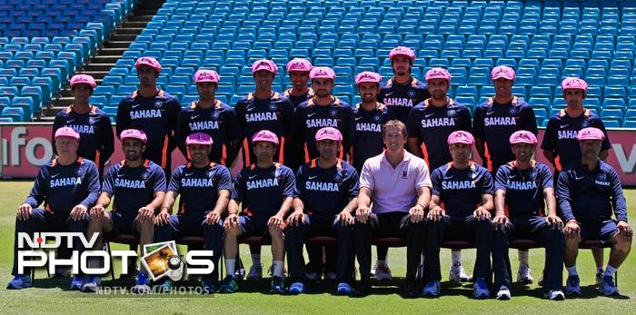 The Indian cricket team members along with former Australia cricket player Glenn McGrath wear 'Baggy Pink' caps prior to a charity team photo at the Sydney Cricket Ground on January 1, 2012 to aid the McGrath Foundation which funds McGrath Breast Care Nurses in communities right across Australia.