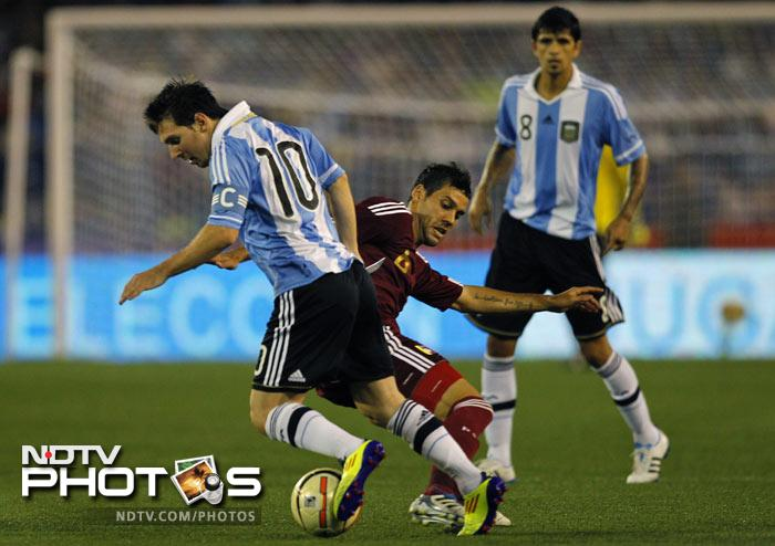 Argentina's Lionel Messi goes past Venezuela's Gabriel Cichero in Kolkata. Messi's presence in the Argentina squad for Friday's friendly against Venezuela created strong interest among locals in Kolkata. (AP Photo)