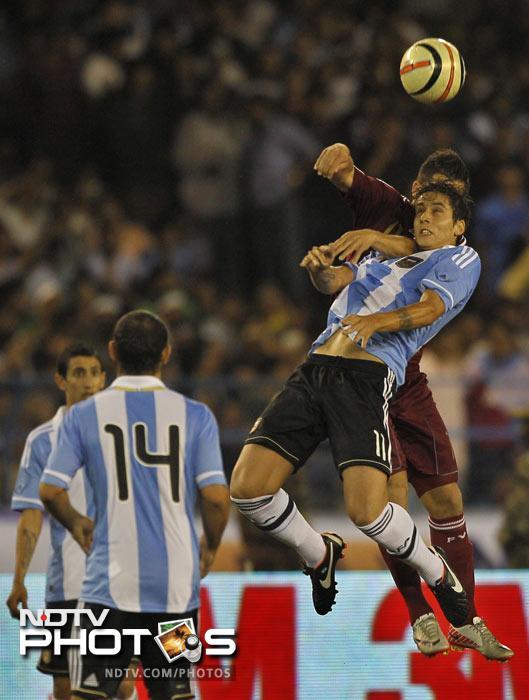 Argentina's Alvarez Ricardo vies for the ball with Venezuela's Alexander Gonzalez during a friendly soccer match in Kolkata. (AP Photo)
