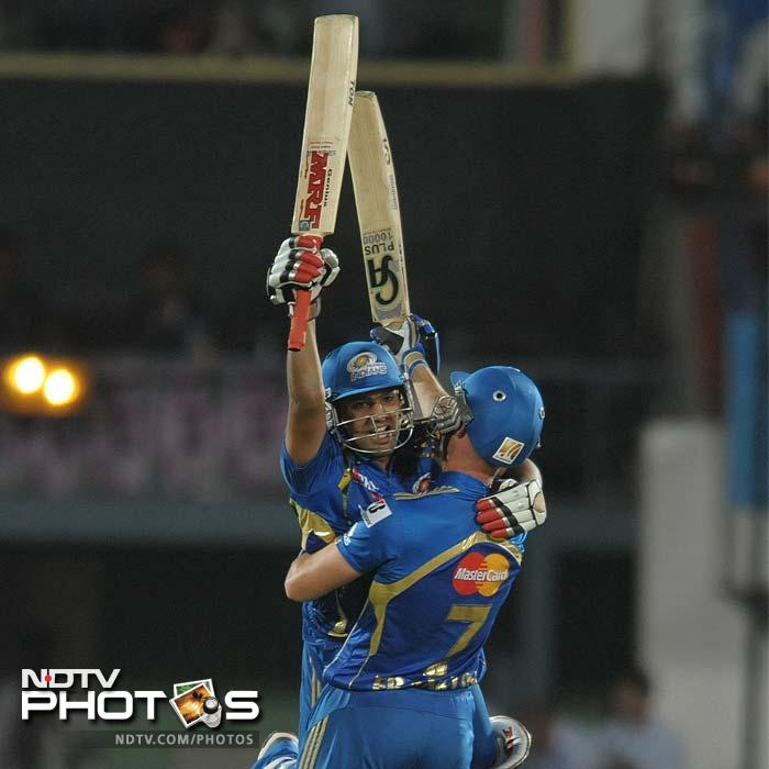 There were many heroes when Mumbai Indians took on Deccan Chargers in the ninth match of the Indian Premier League. It was Rohit Sharma's power though that took the match away from the hosts in Vizag, off the last ball. (AFP PHOTO / Noah SEELAM)