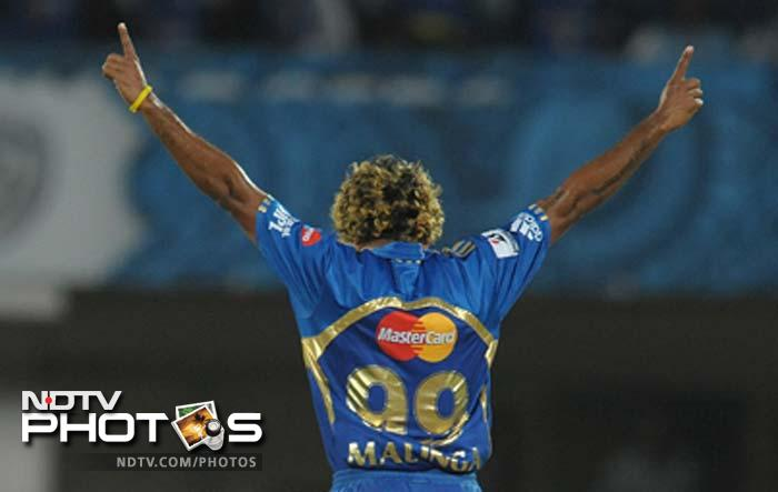 It was Lasith Malinga who gave Mumbai the prized wicket as he dismissed Dhawan after the batsman had struck as many as four sixes and two boundaries. (AFP PHOTO / Noah SEELAM)