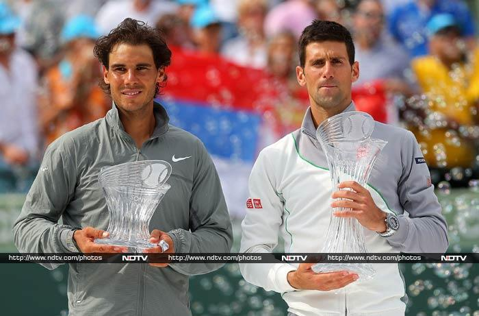Six-time Grand Slam winner Novak Djokovic claimed his fourth Miami Masters crown with a dominating straight sets win over world number one Rafael Nadal on Sunday. Second seed Djokovic cruised to a 6-3, 6-3 win in the men's final of the combined ATP and WTA Tour hardcourt tournament. (All AP and AFP images)
