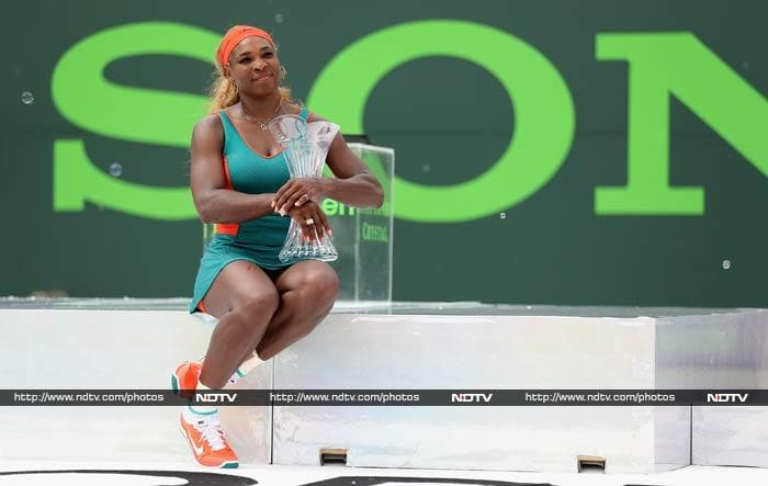 Serena Williams added a second trophy in 2014 to the one she lifted in Brisbane in January and joined Martina Navratilova, Steffi Graf and Chris Evert as the only women in the Open era to win the same title seven or more times.