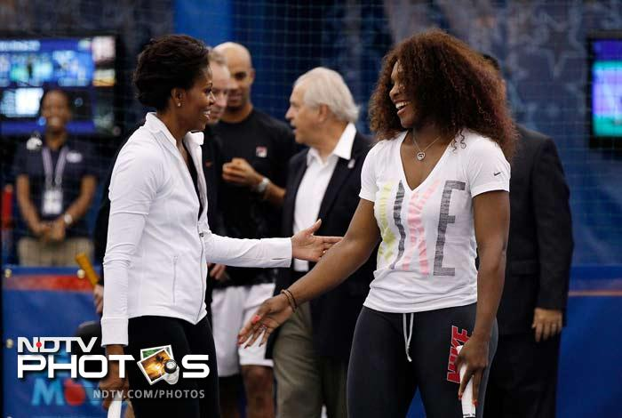 The wife of US President Barrack Obama was then asked to come down to where the action takes place and she was greeted by Serena Williams here.