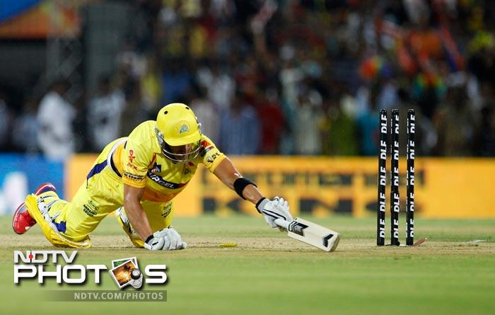 Chennai Super Kings batsman Faf du Plessis dives in an unsuccessful attempt to make it to the crease during an Indian Premier League (IPL) cricket match between and Chennai Super Kings and Mumbai Indians in Chennai. (AP Photo/Aijaz Rahi)