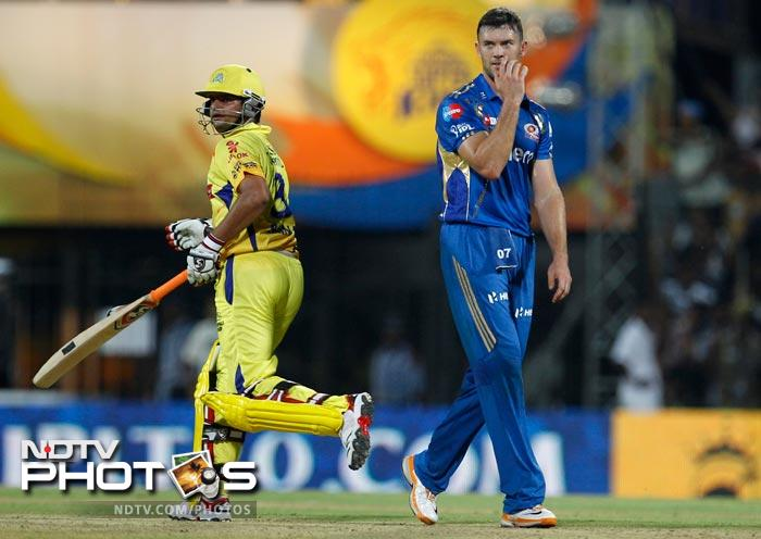 Mumbai Indians' James Franklin, right, reacts after Chennai Super Kings' Suresh Raina, left, hit a boundary on his delivery during their Indian Premier League (IPL) cricket match in Chennai. (AP Photo/Aijaz Rahi)