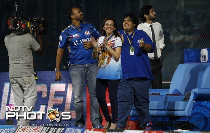 Mumbai Indians team owner Nita Ambani, center, celebrates her team's win in the Indian Premier League (IPL) cricket match against Chennai Super Kings' in Chennai. Mumbai Indians won the match by eight wickets. (AP Photo/Aijaz Rahi)